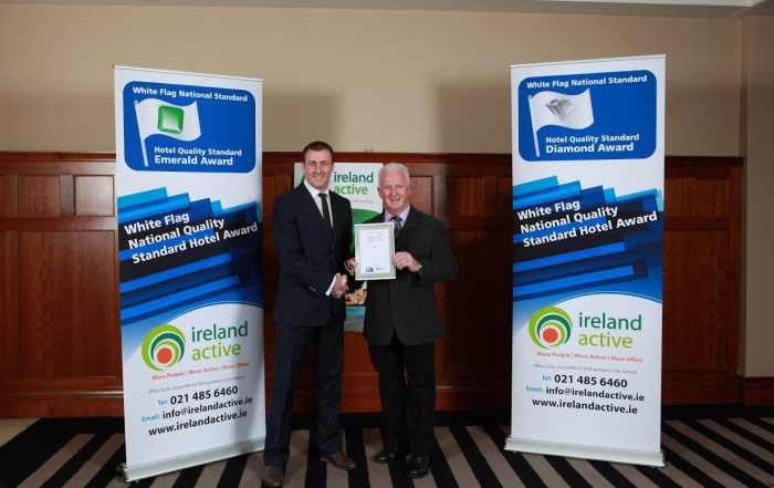 Barry Walsh, Ireland Active President presents Anderson Keys of Waterworld with the Gold Certificate at the recent White Flag awards